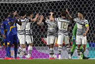 South Korea's Jeong Sang-bin, center, celebrates his side's fifth goal after scoring with teammates against Sri Lanka during their Asian zone Group H qualifying soccer match for the FIFA World Cup Qatar 2022 at Goyang stadium in Goyang, South Korea, Wednesday, June 9, 2021. (AP Photo/Lee Jin-man)