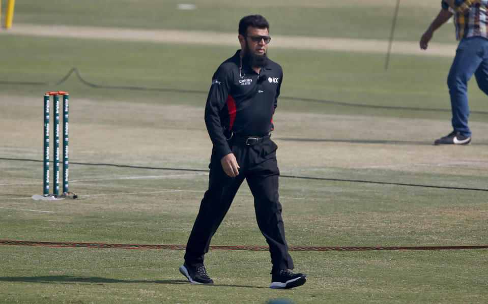 Pakistani umpire Aleem Dar walks back after receiving a souvenir on the record-breaking 210th ODI prior to the start of their 2nd one-day international cricket match between Pakistan and Zimbabwe at the Pindi Cricket Stadium, in Rawalpindi, Pakistan, Sunday, Nov. 1, 2020. Dar achieved the record-breaking 210th ODI as the 52-year-old surpassed South Africa's Rudi Koertzen's record of supervising in most one-day internationals. (AP Photo/Anjum Naveed)