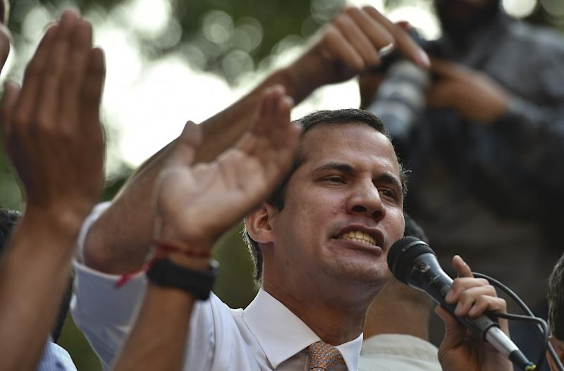 Venezuelan opposition leader and self-proclaimed interim president Juan Guaido speaks during a rally in San Bernardino neighborhood in Caracas on April 1, 2019 (AFP Photo/YURI CORTEZ)