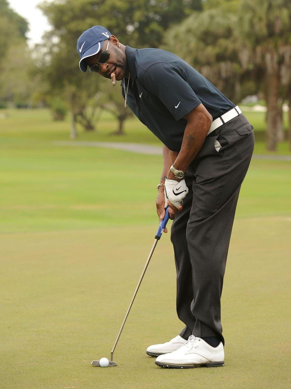 <p>Jerry Rice, stogie in tact, attends the Super Skins Celebrity Golf Classic Tee Off in February 2010. </p>