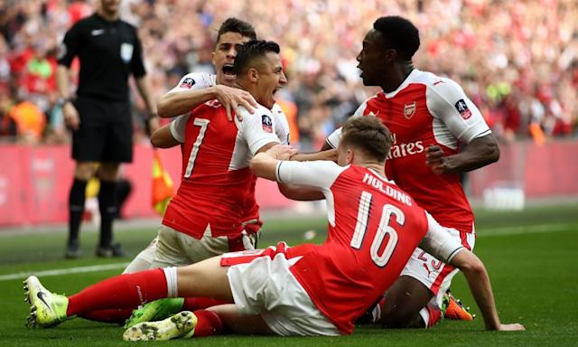 """<span class=""""element-image__caption"""">Alexis Sánchez celebrates after scoring against Manchester City in extra-time to send Arsenal through to the FA Cup final at the expense of Manchester City.</span> <span class=""""element-image__credit"""">Photograph: Julian Finney/Getty Images</span>"""