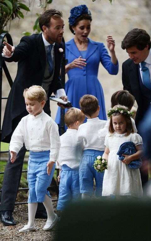 Mummy's little soldier: Prince George practices his marching skills in front of his mother, the Duchess of Cambridge - Credit: Mark Stewart Photography