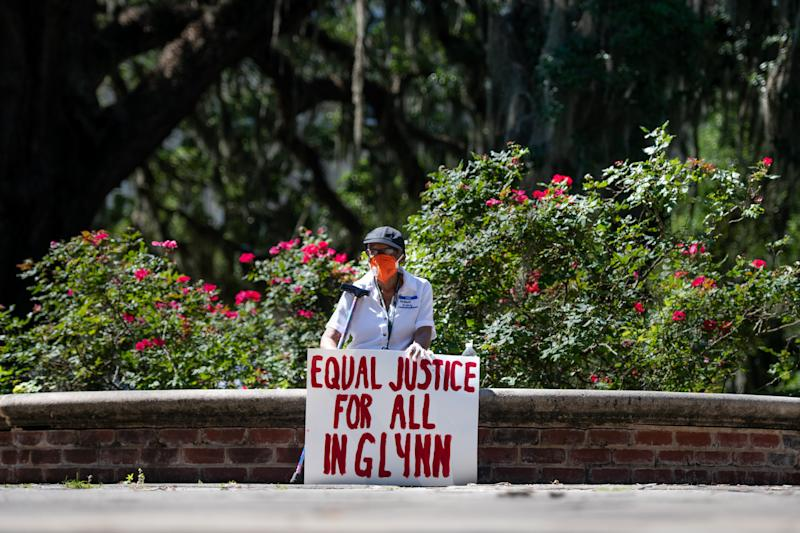BRUNSWICK, GA - MAY 08: A demonstrators protests the shooting death of Ahmaud Arbery at the Glynn County Courthouse on May 8, 2020 in Brunswick, Georgia. Gregory McMichael and Travis McMichael were arrested the previous night and charged with murder. (Photo by Sean Rayford/Getty Images)
