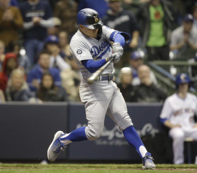 Los Angeles Dodgers' Enrique Hernandez hits a three-run home run against the Milwaukee Brewers during the eighth inning of a baseball game Friday, April 19, 2019, in Milwaukee. (AP Photo/Jeffrey Phelps)