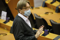 FILE - In this May 27, 2020, file photo, member of the European Parliament Guy Verhofstadt speaks as he wears a face mask, to protect against the coronavirus, during the plenary at the European Parliament in Brussels. The European Union still hasn't completely sorted out its messy post-divorce relationship with Britain — but it has already been plunged into another major crisis. This time the 27-member union is being tested as Poland and Hungary block passage of its budget for the next seven years and an ambitious package aimed at rescuing economies ravaged by the coronavirus pandemic. (AP Photo/Olivier Matthys, File)