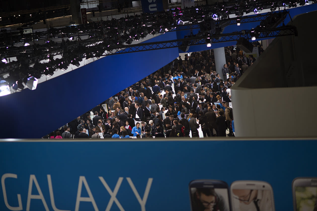 Visitors are seen in one of the pavilion of the Mobile World Congress.