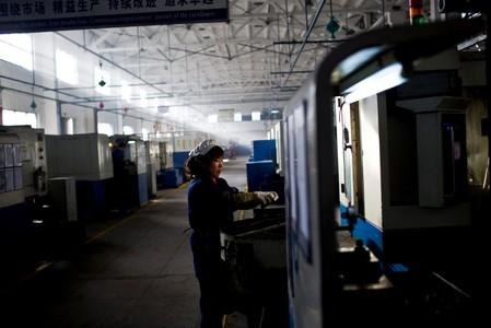 FILE PHOTO: An employee works at a production line at a Wanxiang electric vehicle factory in Hangzhou