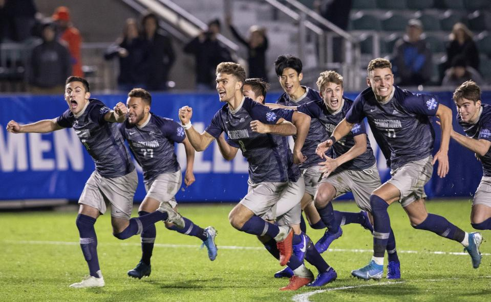 Georgetown celebrates as they win the NCAA college soccer championship in the seventh round of penalty kicks against Virginia in Cary, N.C., Sunday, Dec. 15, 2019. (AP Photo/Ben McKeown)