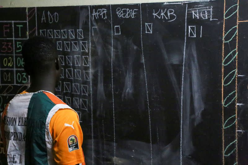 An election official counts the ballots during the presidential election in Abidjan