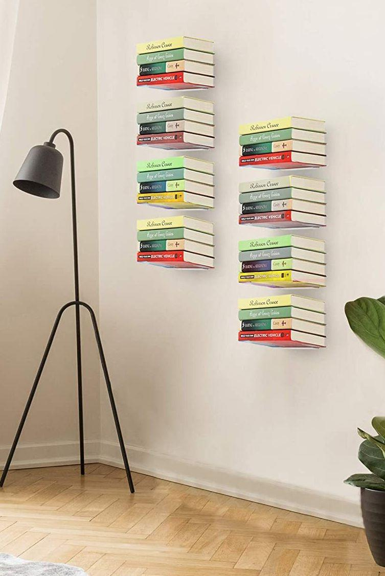 """Hang these on your wall, andyou can justify your expansive library of books (many of which you haven't picked up in years but are adamant about keeping). They're also a practical way to decorate an empty wall!<br /><br /><strong>Promising review:</strong>""""<strong>Saves space!</strong>I'm pretty basic when it comes to tools and installing things, but I was able to hang these alone without any problems.<strong>I love them and they look great!</strong>Would buy again if I need more."""" —<a href=""""https://www.amazon.com/dp/B0146J8XK4?tag=huffpost-bfsyndication-20&ascsubtag=5834502%2C36%2C46%2Cd%2C0%2C0%2C0%2C962%3A1%3B901%3A2%3B900%3A2%3B974%3A3%3B975%3A2%3B982%3A2%2C16271127%2C0"""" target=""""_blank"""" rel=""""noopener noreferrer"""">Brandy Helton</a><br /><br /><strong>Get a set of three from Amazon for<a href=""""https://www.amazon.com/dp/B0146J8XK4?tag=huffpost-bfsyndication-20&ascsubtag=5834502%2C36%2C46%2Cd%2C0%2C0%2C0%2C962%3A1%3B901%3A2%3B900%3A2%3B974%3A3%3B975%3A2%3B982%3A2%2C16271127%2C0"""" target=""""_blank"""" rel=""""noopener noreferrer"""">$27.99</a>(also available in a set of four).</strong>"""