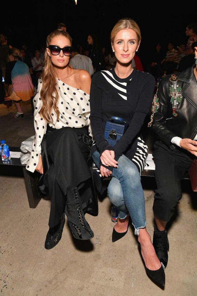 <p>Paris Hilton and Nicky Hilton Rothschild attend the Monse Spring 2019 show during New York Fashion Week at SIR Stage 37 on September 7, 2018 in New York City. (Photo: Dia Dipasupil/Getty Images) </p>