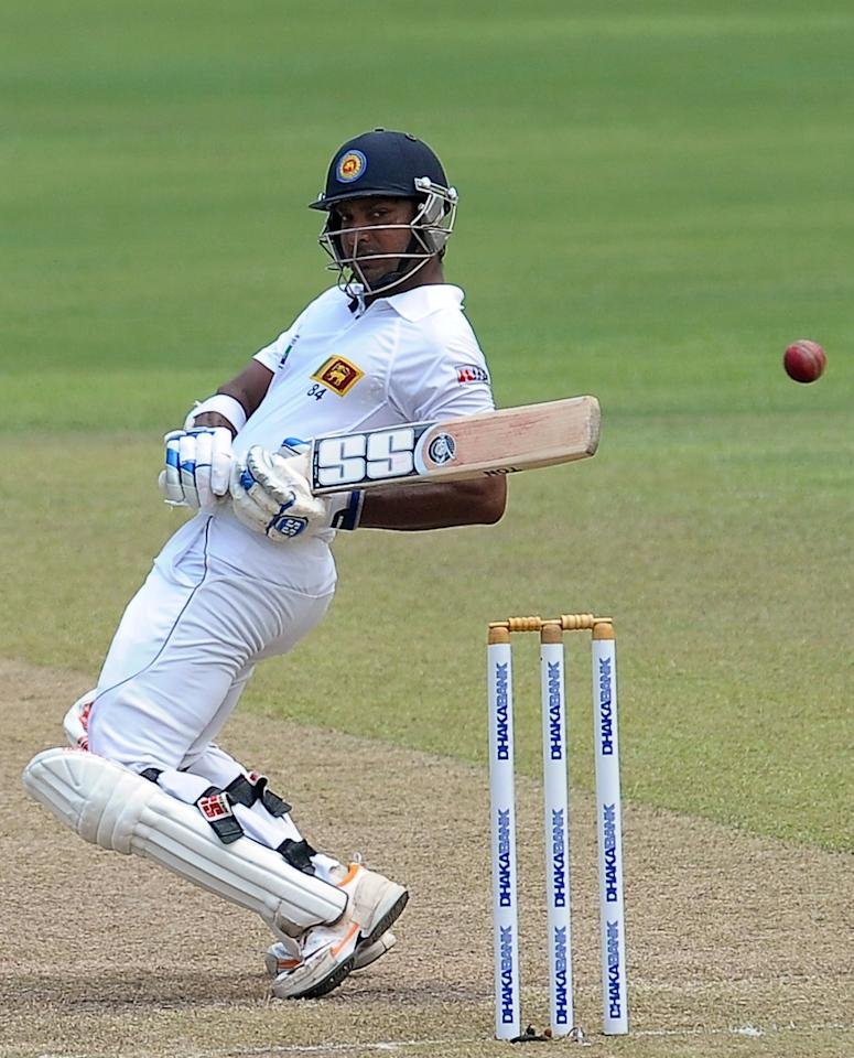 Sri Lankan cricketer Kumar Sangakkara tries to avoid a bouncer  during the second day of their second Test match between Sri Lanka and Bangladesh at the R. Premadasa Cricket Stadium in Colombo on March 17, 2013. AFP PHOTO/ LAKRUWAN WANNIARACHCHI
