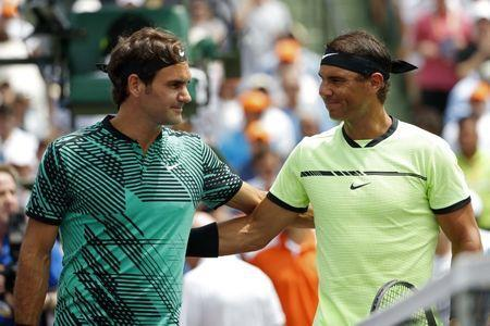 Apr 2, 2017; Key Biscayne, FL, USA; Roger Federer of Switzerland (L) and Rafael Nadal of Spain (R) prior to their match in the men's singles championship of the 2017 Miami Open at Crandon Park Tennis Center. Mandatory Credit: Geoff Burke-USA TODAY Sports