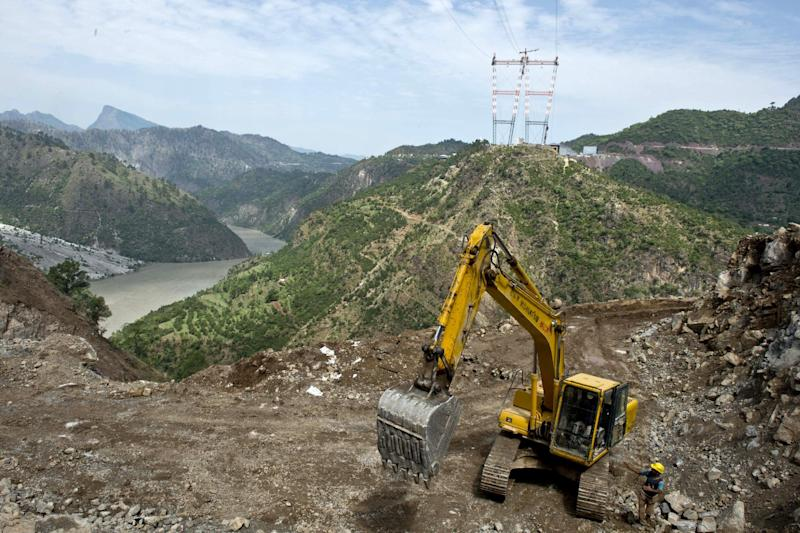 Labourers work at the site of the world's highest railway bridge under-construction over the Chenab river in Kauri in northern Jammu and Kashmir state, July 5, 2014 (AFP Photo/Prakash Singh)