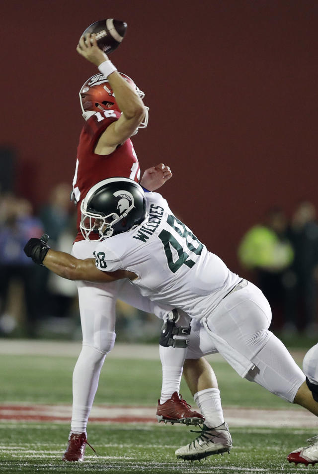 Indiana quarterback Peyton Ramsey throws an interception for a touchdown as he is hit by Michigan State's Kenny Willekes during the first half of an NCAA college football game, Saturday, Sept. 22, 2018, in Bloomington, Ind. (AP Photo/Darron Cummings)