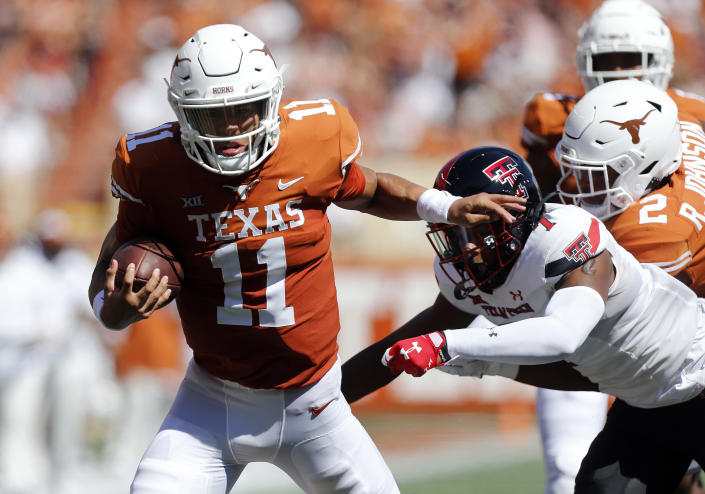 AUSTIN, TX - SEPTEMBER 25: University of Texas Long Horns Casey Thompson (11) runs the ball during the game against  the Texas Tech Red Raiders on September 25, 2021, at Darrell K Royal - Texas Memorial Stadium in Austin, TX. (Photo by Adam Davis/Icon Sportswire via Getty Images)