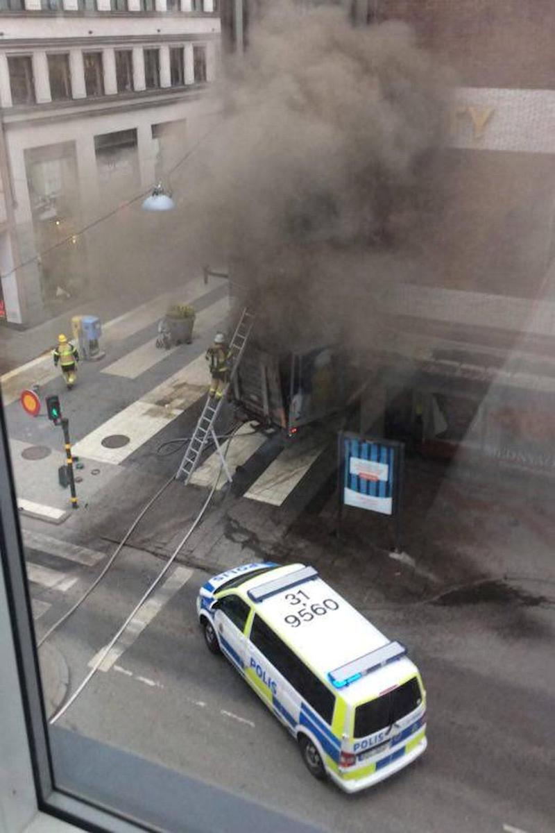 Truck attack: Smoke pours from the shopping centre in Drottninggatan (REUTERS)