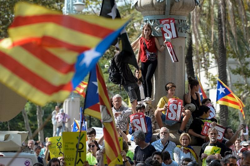 In Barcelona, several thousand protesters flooded the streets for a second day running after police detained key members of the team organising the October 1 vote (AFP Photo/Josep LAGO)