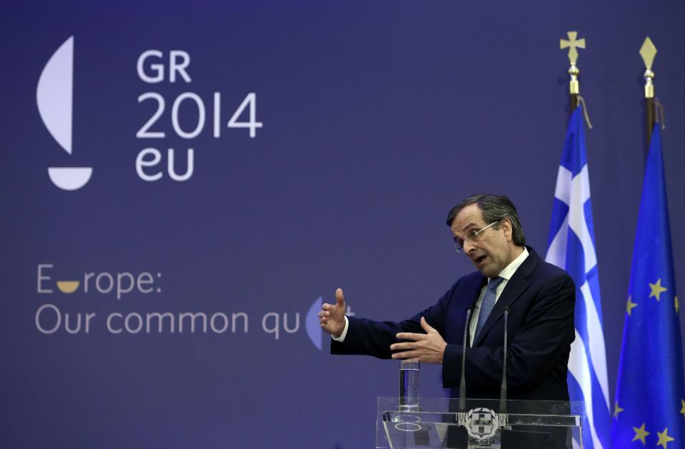 Greece's Prime Minister Antonis Samaras gestures as he speaks during a press conference with European Parliament President Martin Schulz in Athens, Tuesday, Nov. 26, 2013. Samaras says he wants a quick deal in austerity talks with bailout creditors so his country can focus on the rotating European Union presidency that it assumes on January 1, 2014. (AP Photo/Thanassis Stavrakis)