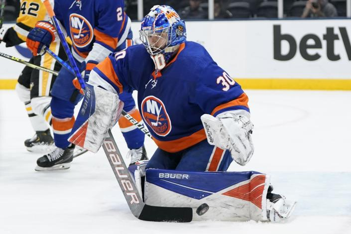 New York Islanders goaltender Ilya Sorokin (30) stops a shot on goal during the third period of Game 4 of an NHL hockey Stanley Cup first-round playoff series against the Pittsburgh Penguins, Saturday, May 22, 2021, in Uniondale, N.Y. The Islanders won 4-1. (AP Photo/Frank Franklin II)