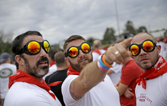 Eddy Fernandez, left, Mike Woodside, center, both of Atlanta, and Michael Kelley, of Knoxville, Tenn., wear goggles before running alongside charging bulls during the Great Bull Run at the Georgia International Horse Park, Saturday, Oct. 19, 2013, in Conyers, Ga. The event, expected to attract 3,000 runners Saturday, is inspired by the annual running of the bulls in Pamplona, Spain and has future stops planned in Texas, Florida, California, Illinois and Pennsylvania. (AP Photo/David Goldman)