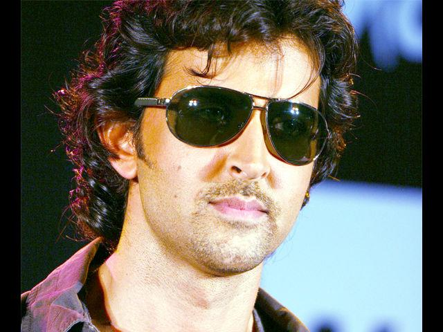 <b>9. Hrithik Roshan</b><br> The Greek God of Bollywood, Hrithik Roshan oozes class, confidence and style. He's got the look, he's got the body and he's got the fashion sense to make every woman go weak in the knee. From well-fitted blazers to his standard washed out jeans and crisp pink shirts, this hottie always knows what he's up to.