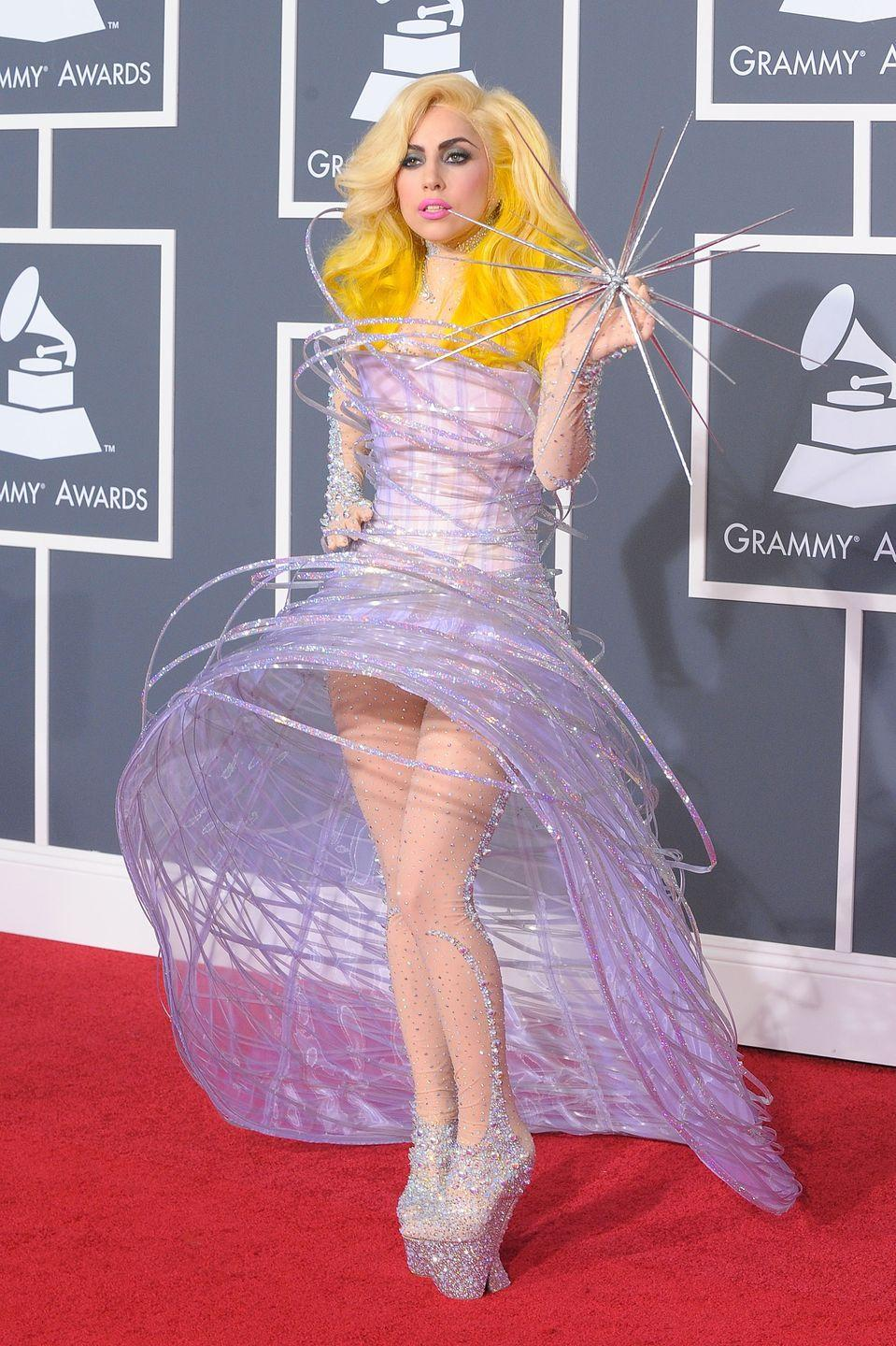<p>At the turn of the decade Lady Gaga was riding high off the release of hits such as 'Paparazzi', 'Bad Romance' and 'Telephone', and was experimenting with a more futuristic aesthetic - summed up by her appearance at the 2010 Grammys. The singer arrived wearing a sculptural Giorgio Armani dress covered in glittering tubes, paired with towering crystal-encrusted platforms. She carried in her hand a spiked star, finishing off the galactic look. <br></p>