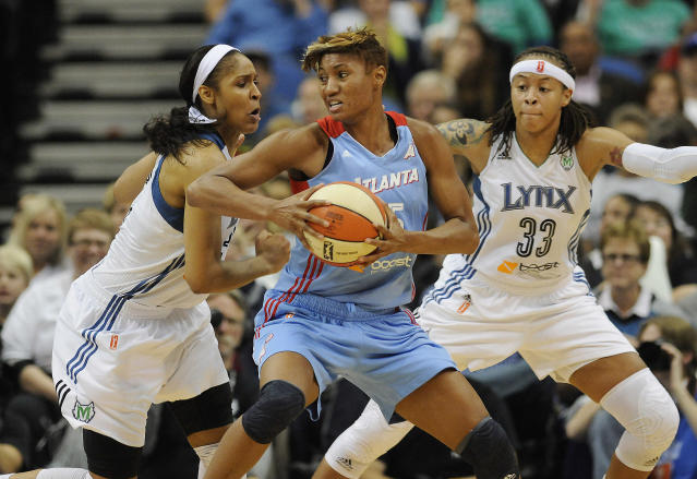 Atlanta Dream guard Angel McCoughtry (35) tries to protect the ball against Minnesota Lynx forward Maya Moore, left, and guard Seimone Augustus (33) during Game 1 of the WNBA basketball Finals, Sunday, Oct. 6, 2013, in Minneapolis. The Lynx won 84-59. (AP Photo/Stacy Bengs)
