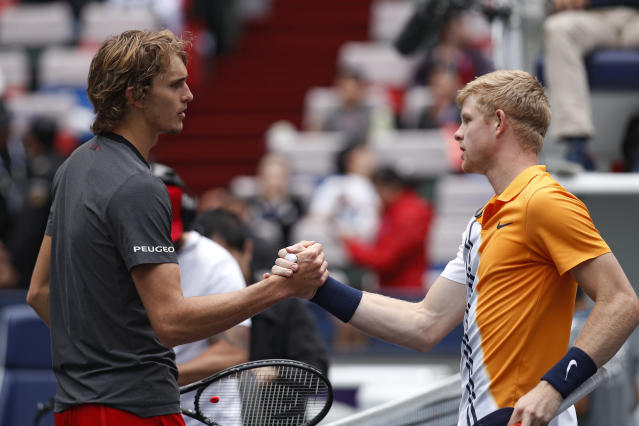 Alexander Zverev of Germany, left, shakes hands with Kyle Edmund of Britain after winning the men's singles quarterfinals match in the Shanghai Masters tennis tournament at Qizhong Forest Sports City Tennis Center in Shanghai, China, Friday, Oct. 12, 2018. (AP Photo/Andy Wong)