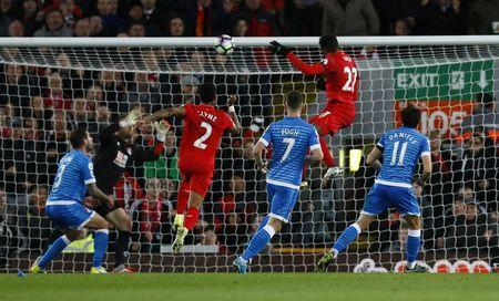 Britain Soccer Football - Liverpool v AFC Bournemouth - Premier League - Anfield - 5/4/17 Liverpool's Divock Origi scores their second goal Action Images via Reuters / Jason Cairnduff Livepic