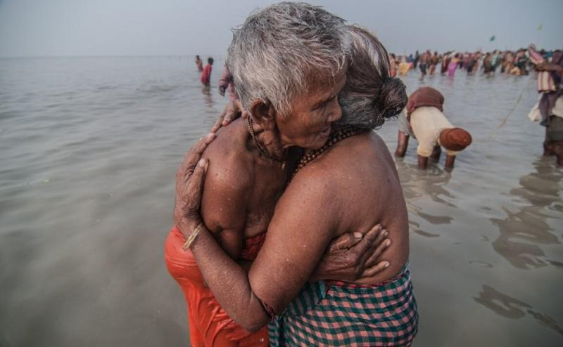 After the holy dip devotees hugs each other
