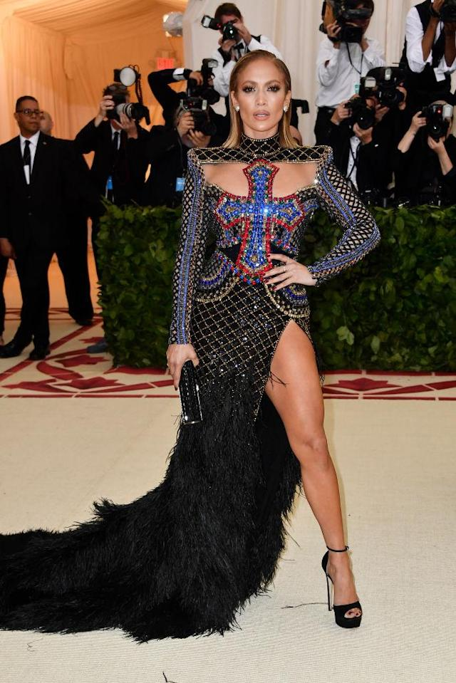 <p>The religious theme couldn't stop JLo from showing some thigh in this Balmain creation. (Photo: Getty Images) </p>