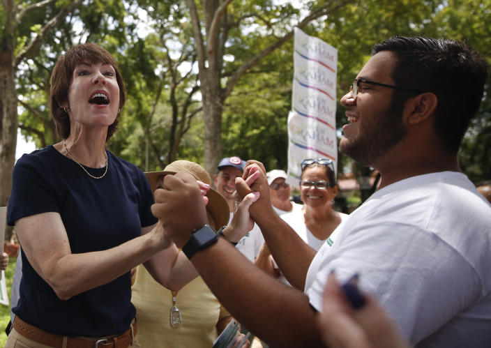 """FILE- In this Aug. 18, 2018, file photo Democratic gubernatorial candidate Gwen Graham thanks a campaign volunteer, Juan Sabater, 20, of Miami as she speaks to voters in an early """"Get Out The Vote"""" tour in Miami Lakes, Fla. Rhode Island Gov. Gina Raimondo and U.S. Rep. Graham of Florida are among nine women running for governor who will face primary voters in coming weeks. No more than nine women have ever led states at the same time. (AP Photo/Brynn Anderson, File)"""