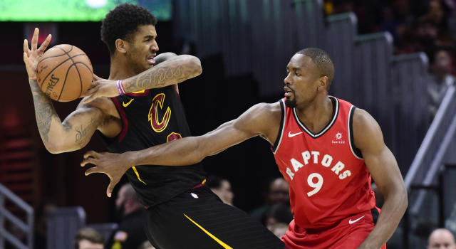 Cleveland's Marquese Chriss and Toronto's Serge Ibaka battle for possession. (Photo by Jason Miller/Getty Images)