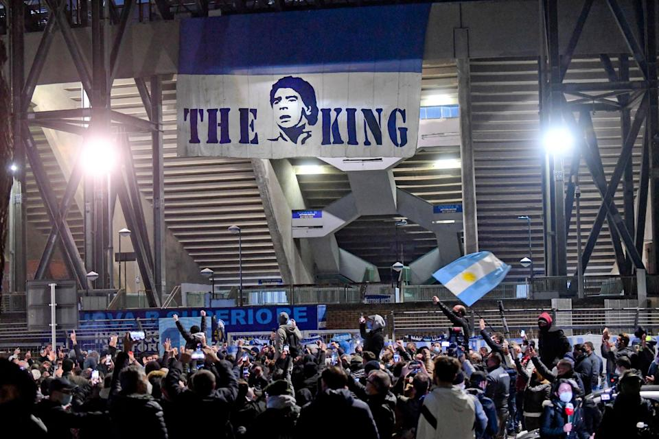 <p>Fans gathered at the San Paolo stadium to pay tribute to Maradona in Naples</p> (AFP via Getty)