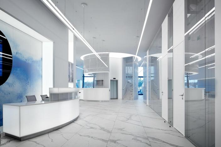 The main entrance to the new lounge is sleek, white, and minimal.