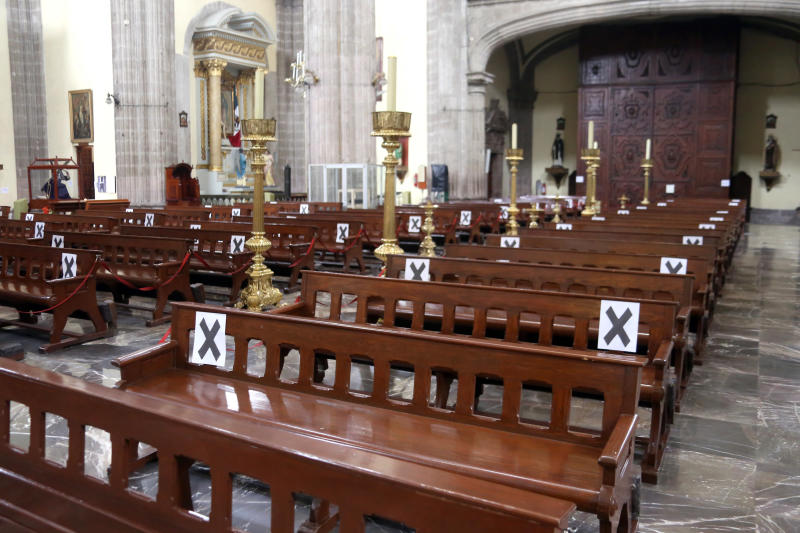 MEXICO CITY, MEXICO - JUNE 30: View of marks inside a church indicating the places allowed to take a seat during the reopening of the Historic Center after three months on June 30, 2020 in Mexico City, Mexico. As ICU occupancy trends downward, authorities downgraded the alert level from red to orange in Mexico City. Economic activity starts reopening gradually following a staggered schedule, with restrictions and preventive measures. (Photo by Adrián Monroy/Medios y Media/Getty Images)