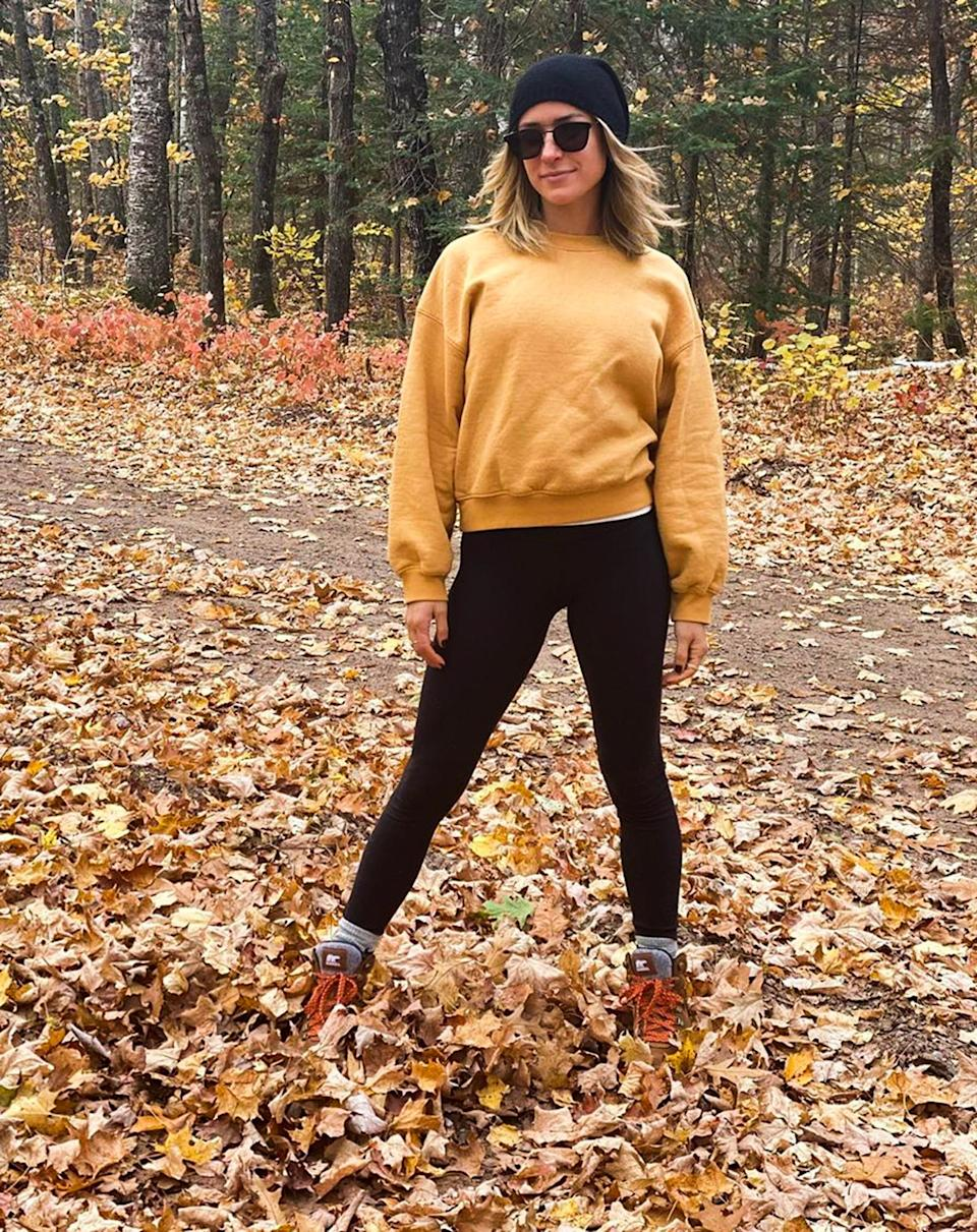 <p>Kristin Cavallari walks through tree-lined trails and enjoys the foliage wearing Sorel Kinetic Conquest boots.</p>