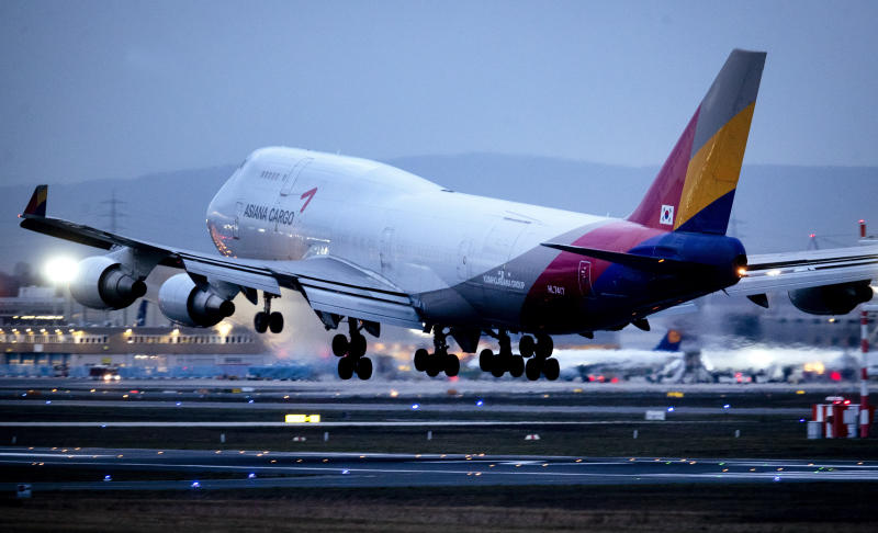 A Boeing 747 of Asiana Airlines lands at the airport in Frankfurt, Germany, Sunday, March 1, 2020. The aviation industry expects heavy financial losses due to the Covid-19 virus. (AP Photo/Michael Probst)