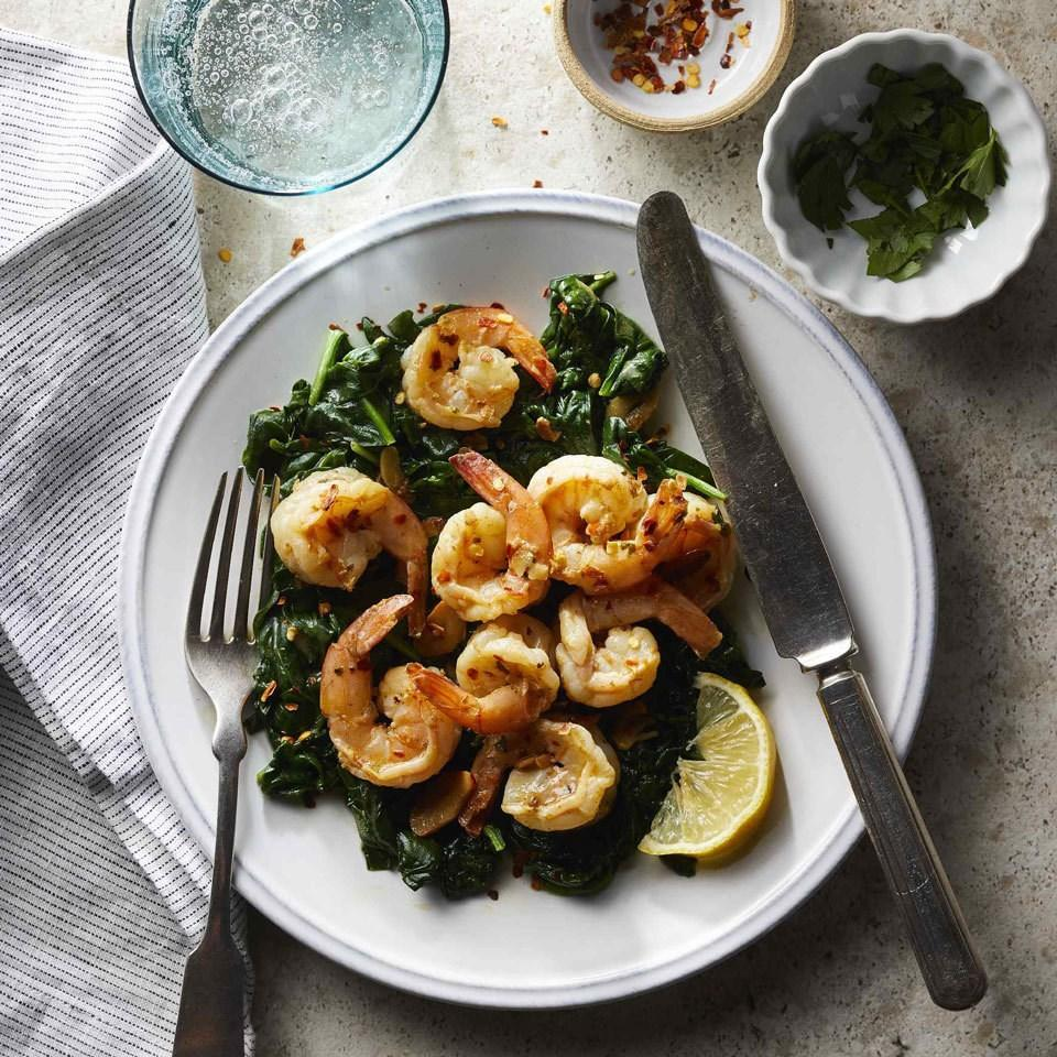 <p>Shrimp, spinach and garlic brown and cook quickly for a simple one-pot weeknight dinner. A fast pan sauce gets life from zesty lemon juice, warm crushed red pepper and herby parsley. Serve with a slice of whole-wheat baguette to swipe up every last drop of sauce.</p>