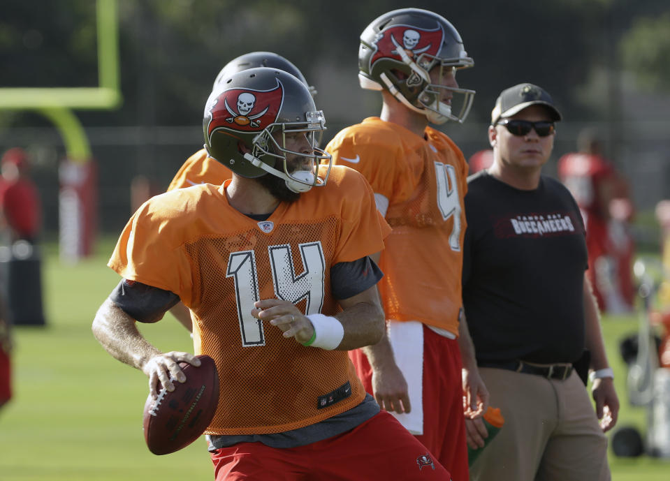 FILE - In this July 28, 2018, file photo, Tampa Bay Buccaneers quarterback Ryan Fitzpatrick (14) throws a pass during an NFL football training camp practice in Tampa, Fla. Ryan Fitzpatrick jokes that he thought he had seen it all during a 13-year career as a starter and backup quarterback. Now, he's preparing to lead the Buccaneers during Jameis Winston's three-game suspension for violating the NFL's personal conduct policy. (AP Photo/Chris O'Meara, File)