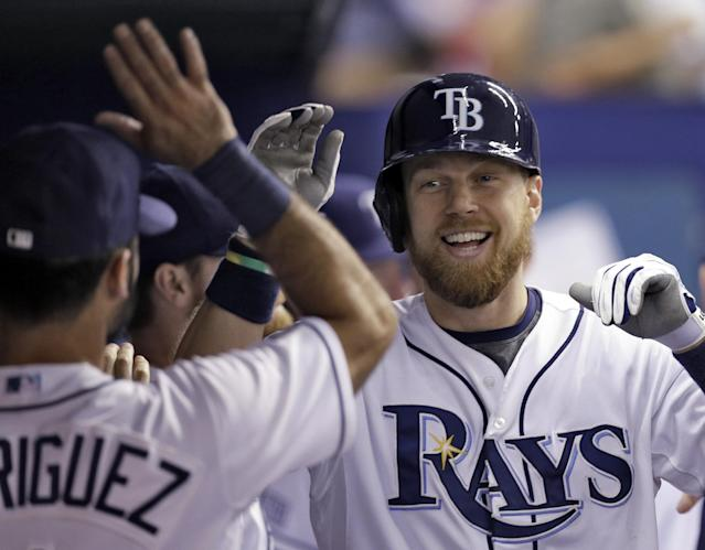 Tampa Bay Rays' Ben Zobrist, right, high-fives teammate Sean Rodriguez after hitting a home run off Boston Red Sox starting pitcher John Lackey during the seventh inning of a baseball game on Saturday, July 26, 2014, in St. Petersburg, Fla. (AP Photo/Chris O'Meara)