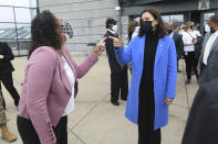 Michigan Governor Gretchen Whitmer, right, shares a laugh with State Rep. (District 55) Felicia Brabeck, outside the Eastern Michigan University Convocation Center, Monday, April 12, 2021, where Whitmer and U.S. Rep. Debbie Dingell were visiting with volunteers and local civic leaders at the COVID-19 Vaccination Clinic set up inside the center. (Lon Horwedel/Detroit News via AP)