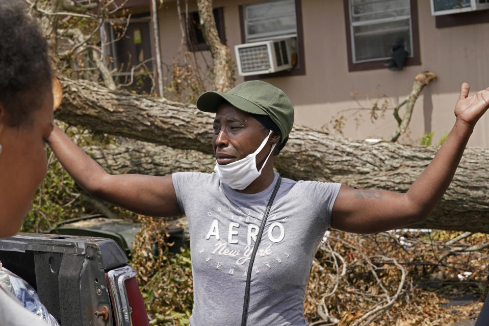 Linda Smoot, who evacuated from Hurricane Laura in a pickup truck with eight others, reacts outside her sister's home, as they return to see their homes for the first time, in Lake Charles, La., in the aftermath of the hurricane, Sunday, Aug. 30, 2020. (AP Photo/Gerald Herbert)