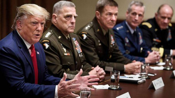 PHOTO: President Donald Trump speaks during a meeting with senior military leaders including Chairman of the Joint Chiefs of Staff Army General Mark A. Milley, seated next to Trump, in the Cabinet Room of the White House Oct. 7, 2019. (Brendan Smialowski/AFP via Getty Images)