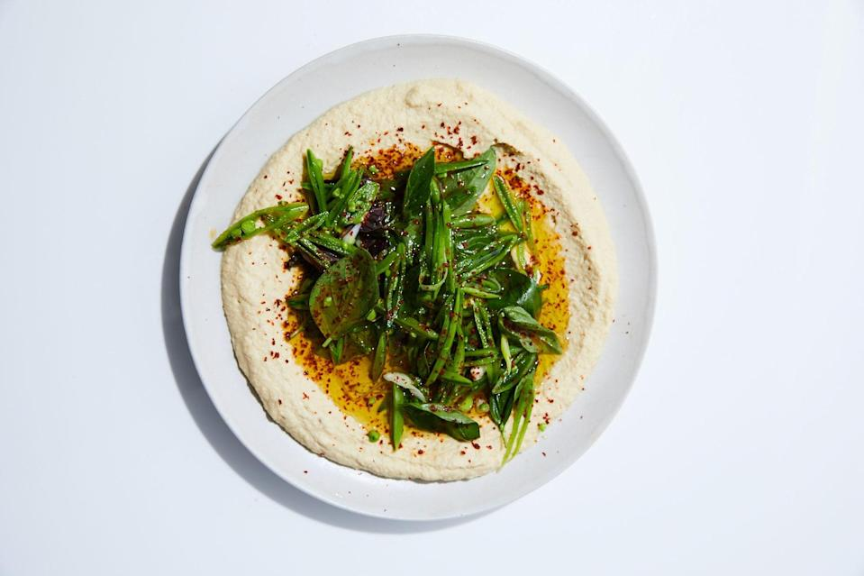 """Try seeking out a high-quality Sauvignon Blanc vinegar. You'll be amazed at how much it brightens these sugar snap peas. This recipe was developed by <a href=""""https://www.tuskpdx.com/"""" rel=""""nofollow noopener"""" target=""""_blank"""" data-ylk=""""slk:Tusk"""" class=""""link rapid-noclick-resp"""">Tusk</a> in Portland, OR. <a href=""""https://www.bonappetit.com/recipe/hummus-with-sugar-snap-peas-and-basil?mbid=synd_yahoo_rss"""" rel=""""nofollow noopener"""" target=""""_blank"""" data-ylk=""""slk:See recipe."""" class=""""link rapid-noclick-resp"""">See recipe.</a>"""