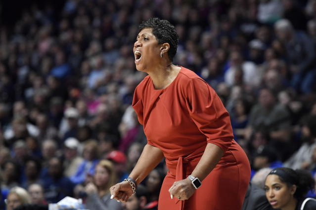 Cincinnati's Michelle Clark-Heard calls out to her team during the first half of an NCAA college basketball game in the American Athletic Conference tournament finals against Connecticut at Mohegan Sun Arena, Monday, March 9, 2020, in Uncasville, Conn. (AP Photo/Jessica Hill)
