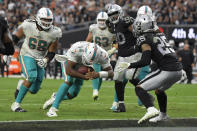 Miami Dolphins quarterback Jacoby Brissett (14) runs in for a touchdown against the Las Vegas Raiders during the second half of an NFL football game, Sunday, Sept. 26, 2021, in Las Vegas. (AP Photo/David Becker)