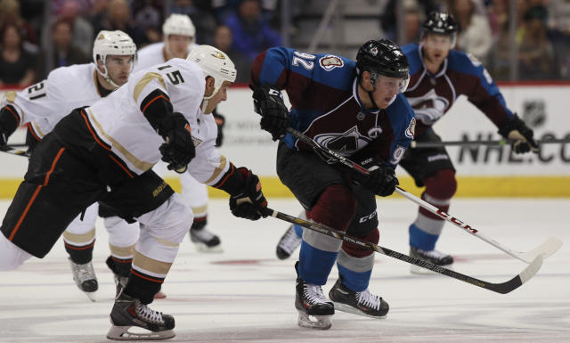 Anaheim Ducks center Ryan Getzlaf, left, reaches out with his stick and is called for hooking on Colorado Avalanche left wing Gabriel Landeskog, of Sweden, in the third period of the Avalanche's 6-1 victory in a hockey game in Denver on Wednesday, Oct. 2, 2013. (AP Photo/David Zalubowski)