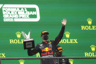 First place, Red Bull driver Max Verstappen of the Netherlands, holds up the trophy on the podium after the Formula One Grand Prix at the Spa-Francorchamps racetrack in Spa, Belgium, Sunday, Aug. 29, 2021. The race was red flagged due to weather conditions. (AP Photo/Francisco Seco)
